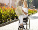 woman-wheelchair-looking-map-outdoors